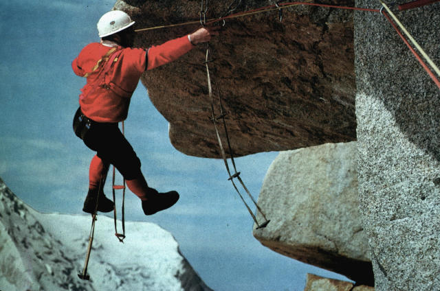 image of a man cliffhanging